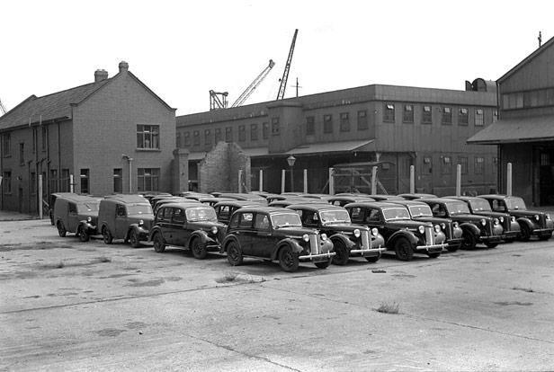 Vans & cars awaiting export, 1950s