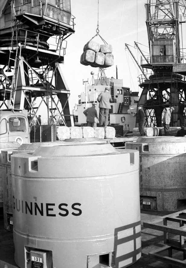 Discharging peat moss and Guinness containers, 3 February 1958