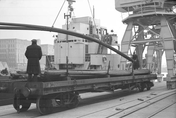 Steel rods being unloaded from mv 'Pluto'