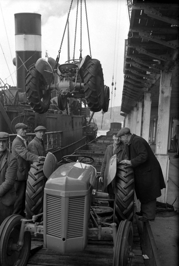 Tractors being hoisted from Quay at Z Shed